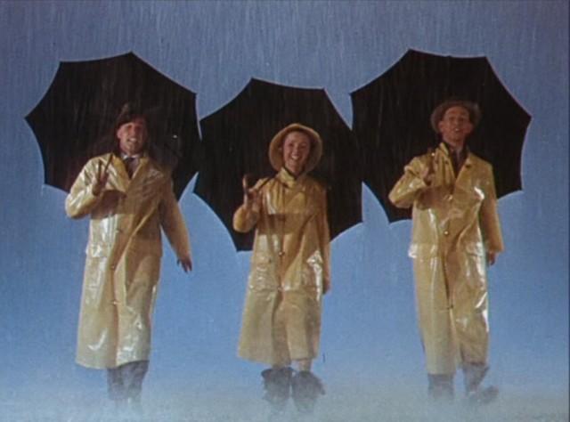 film-chantons-sous-la-pluie-parapluies-cires-jaunes